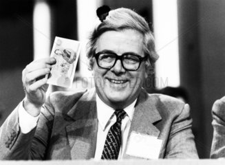 Chancellor Geoffrey Howe with a five-pound note  16 October 1981.