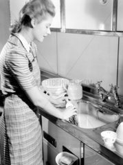 Woman doing the washing up  1950.