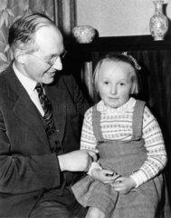Professor Ernest Thomas Walton with his daughter  Jean  20 November 1951.