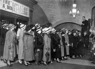 Women in hats queuing for cinema  Carlton Cinema  London  15 may 1935.