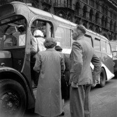 Boarding a tour coach outside St Pancras station  London  1950.