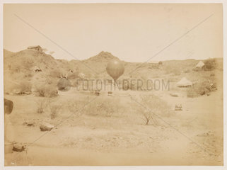 A balloon in a desert setting  1885-1890.