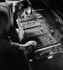 An electronic engineer at MEL tests an an infra red installation  1964.