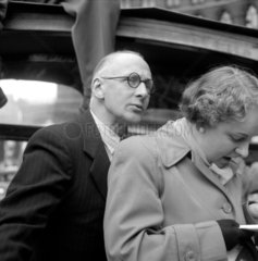 Couple preparing to alight from coach during tour of London  1950.