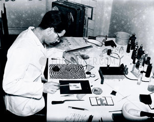 Fingerprint expert analyses a fingerprint for forensic evidence  28 January 1938.