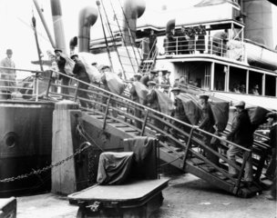 Dockers loading mail bags  1931.