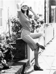 Striped top and checked knee-length shorts  April 1974.