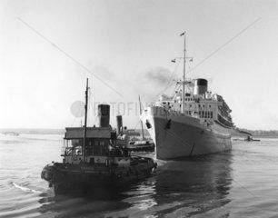 'Oranje' steam ship with tugboat  Ocean Dock  Southampton  1950.