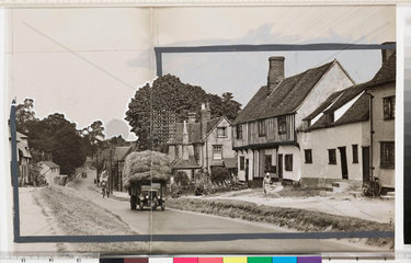 Row of cottages with lorry driving past  Newport  Essex  July 1933.