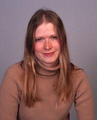 Blonde woman wearing a beige polo-neck jumper  December 2000.