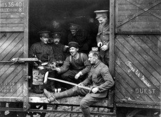 British soldiers preparing food and smoking  1914.
