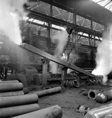 Steam from cooling tube  metal tube production.