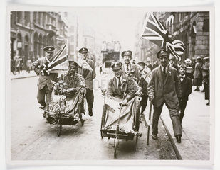 'Peace scenes in London wounded soldiers with flags'  1919.