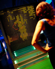 A visitor looking at DigitDot in Digitopolis  Science Museum  London  2000.