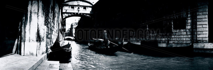 Panoramic view of a gondola on a canal in Venice  c 1910s