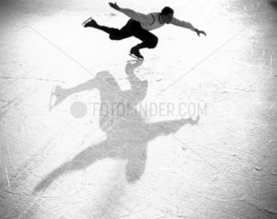 Ice-skater casting a shadow  c 1930s.