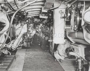 Sailors at work in the interior of a British submarine  1914-1918.