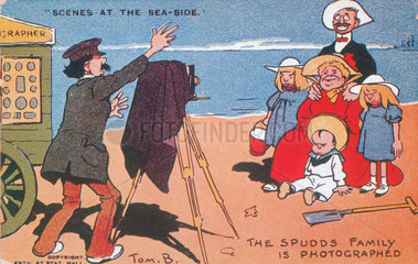 'Scenes at the Sea-Side - the Spud family is photographed'  c 1900.