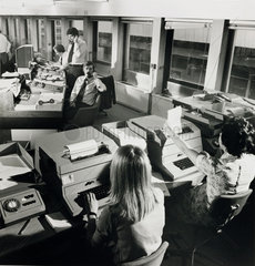 Hofex dealers on telephones with female typists at telex machines  1967.