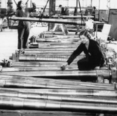 Woman working in a munitions factory  Second World War  August 1942.