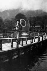 Japanese woman with parasol  c 1900s.