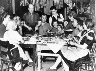 Families eating Sunday dinner  World War Two  3 September 1944.