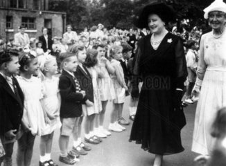 The Queen Mother visiting Peterborough School  Fulham  London  17 July 1952.