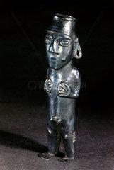 Silver male deity statue  Peruvian.