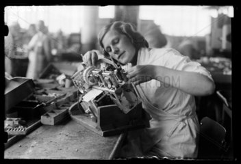 Woman working on the assembly line at the HMV works  Hayes  8 August 1932.