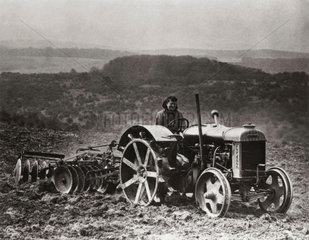 Fordson tractor pulling disc harrow  c 1942.