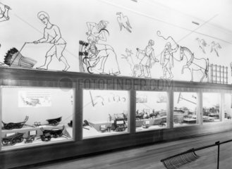 Cyclorama; cases of wagons  reapers  etc  Science Museum  London  1951.