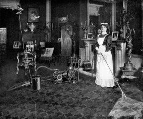 Maid vacuuming carpet  1911.