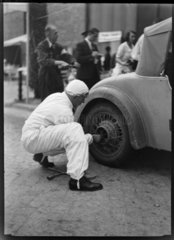 A motor racing car wheel being changed  Germany  c 1934.