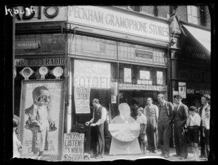 Standing outside a gramaphone shop  1932.
