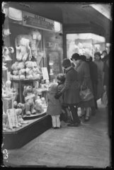 Christmas shopping for toys in Oxford Street  London  1932.