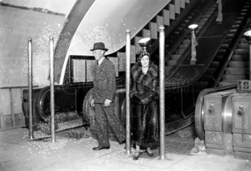Couple demonstrating a safety device  Manor