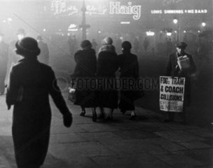 Fog scenes in central London at night  1934.
