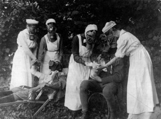 Nurses putting gas masks on wounded German  1914-1918.
