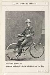 'Coasting Backwards - Sitting Side-saddle on Top Stay'  1901.