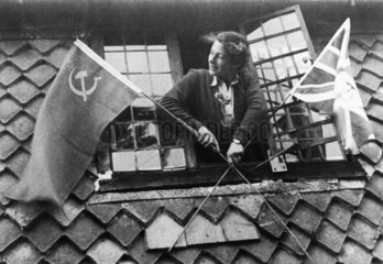 Woman with Union Jack and Soviet flags on VE Day  8 May 1945.