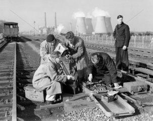 Railway maintenance  c 1956. An engineer ca