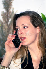 Woman using a mobile phone  April 1997.