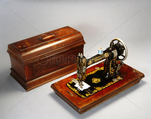 White sewing machine with case  1890-1900.