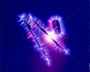 Kirlian photograph of a razor blade and lines of cocaine.