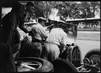 Mechanics working on Albert Divo's Bugatti  AVUS race track  Berlin  1932.