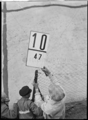 Race worker holding pit signal  Nurburgring  1930s.