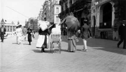 People strolling along the promenade of a F