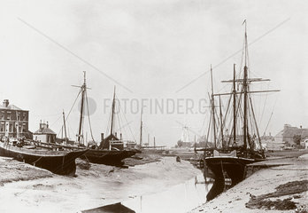 Boats at low tide  late 19th century.