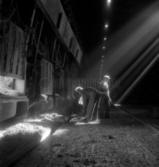 Steelworkers clearing up open hearth furnace floor  United Steel  1947.
