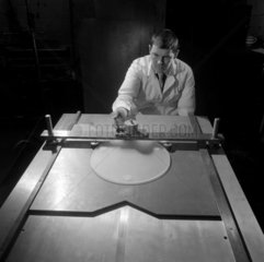 A worker prepares a telescope Schmidt plate at the works of Grubb Parsons.